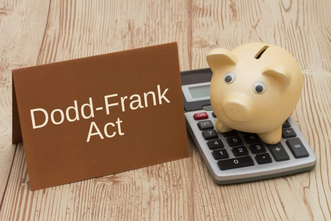 Dodd-Frank Act sign with piggy bank, calculator