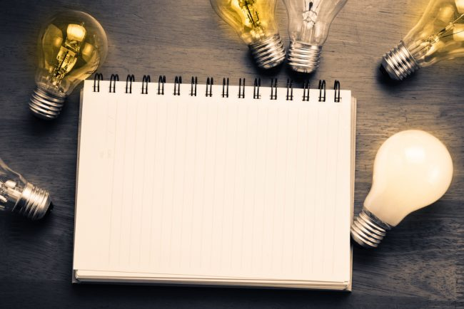 Blank notebook with lightbulbs
