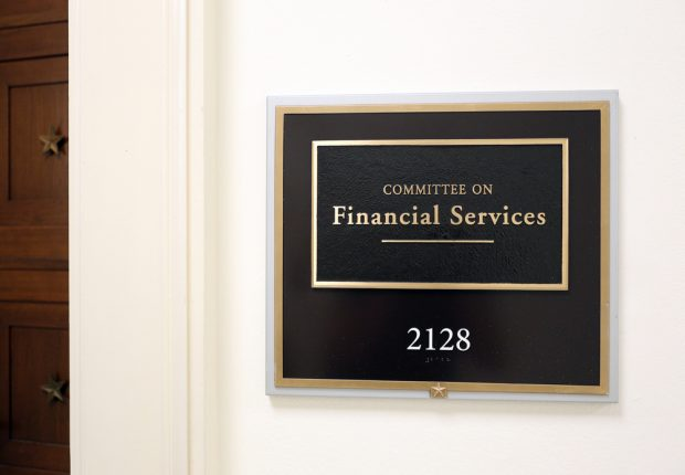 A sign at the entrance to a House Financial Services Committee room in Washington, DC.