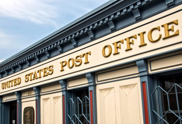 U.S. Post Office sign on a building