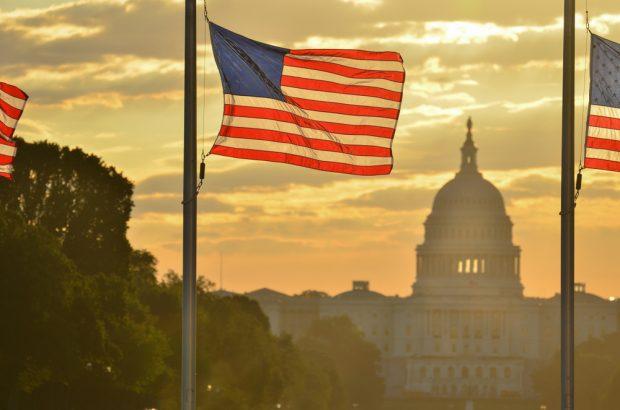 U.S. flag and U.S. Capitol Building