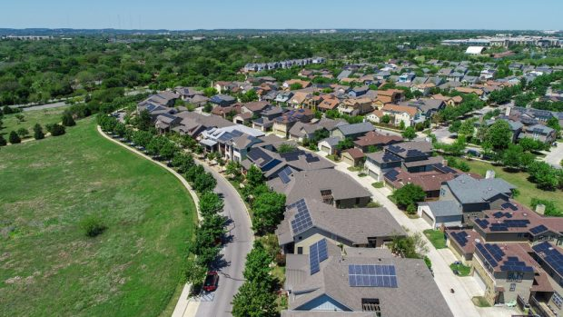 solar panels on suburban homes.