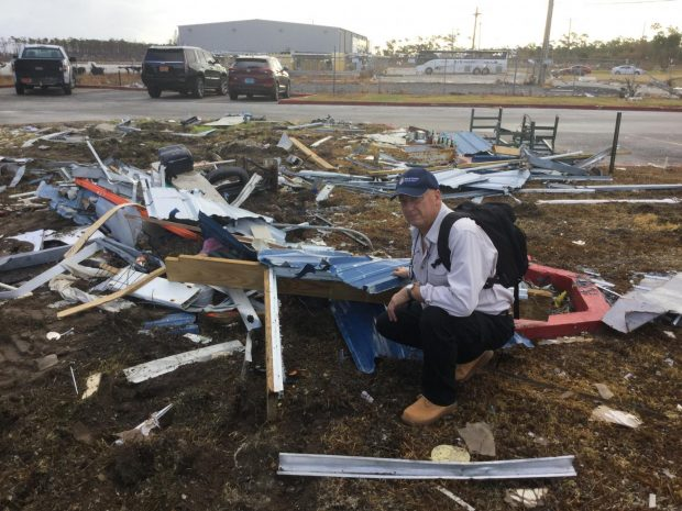 Bruce Foulke, president/CEO of American Heritage FCU, amid some of the debris left by Hurricane Dorian on Grand Bahama during a visit Sept. 12.
