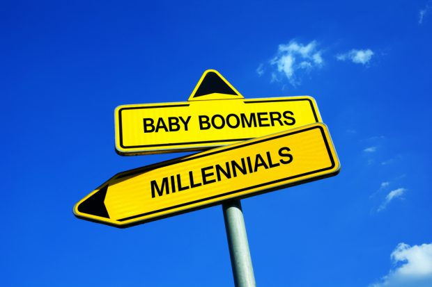 sign that reads baby boombers and millennials