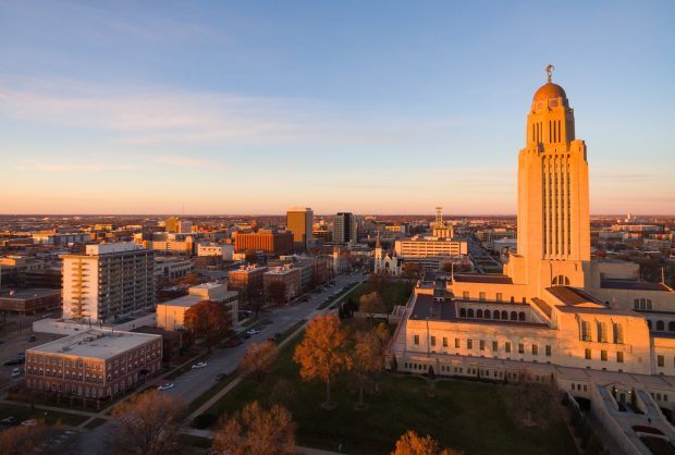 The sun sets over the State Capital Building in Lincoln, Neb.