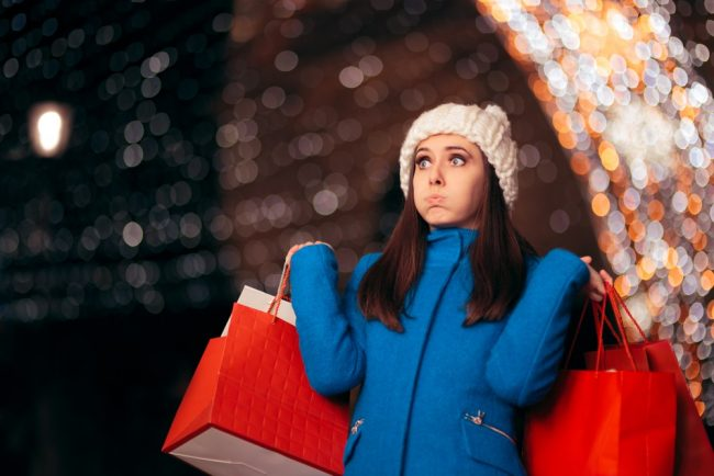 Woman stressed by holiday shopping