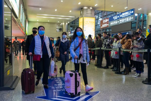 Chengdu, Sichuan / China - January 23 2019: travellers all wear mask at airport to prevent infection from coronavirus.