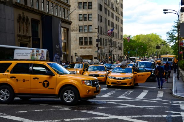 Yellow New York City Taxi driving in Midtown, Manhattan.