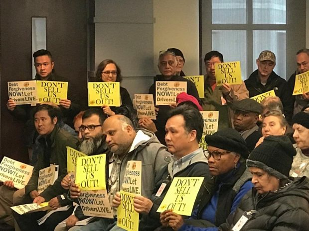 Taxi drivers attend the NCUA board meeting on Thursday, Jan. 23, 2020.