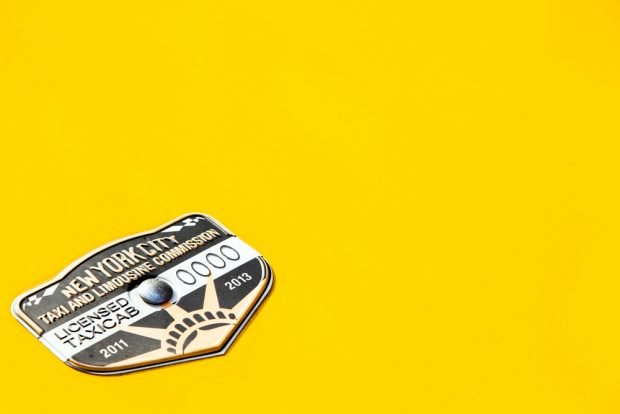 close up of taxi medallion