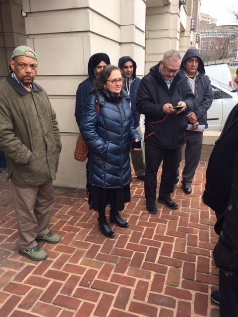 Bhairavi Desai (in the center), executive director of the New York Taxi Workers Alliance stands outside of the NCUA speaking with reporters on Thursday, Feb. 20, 2020.