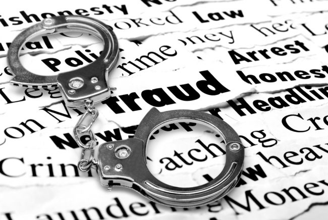 Handcuffs over fraud-related words