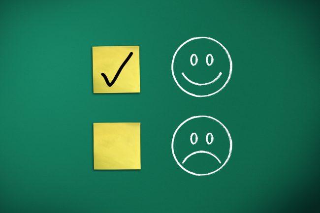 check mark next to a happy face