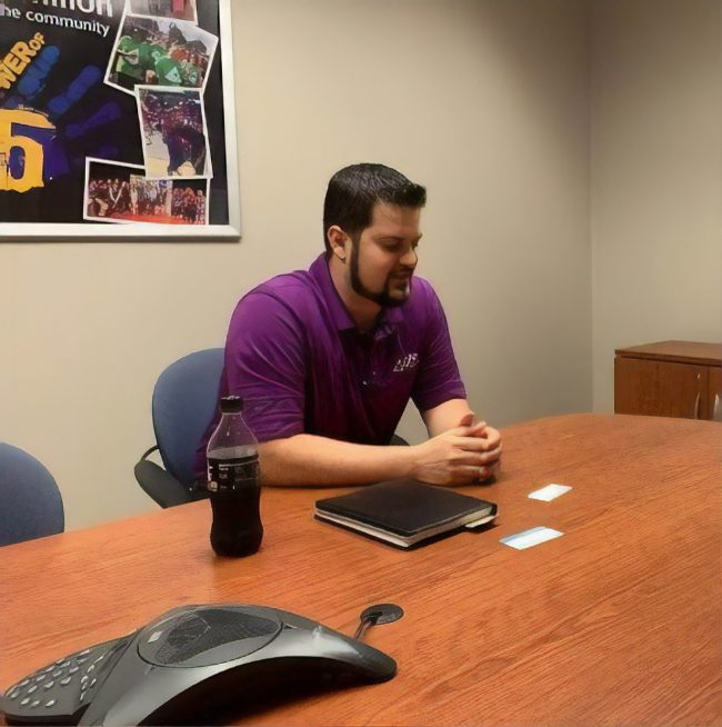 Anthony Padron in a GTE Financial conference room.