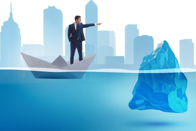 Businessman approaching iceberg