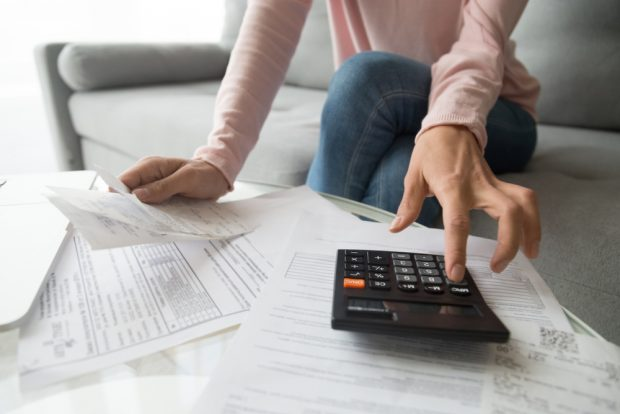 filling out loan application on paper