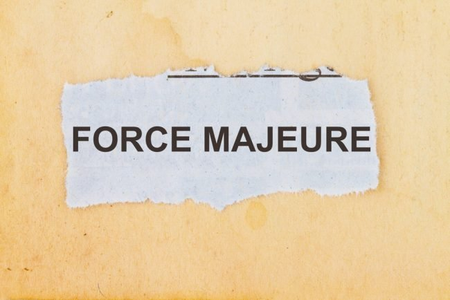 """Torn paper with """"force majeure"""" text"""