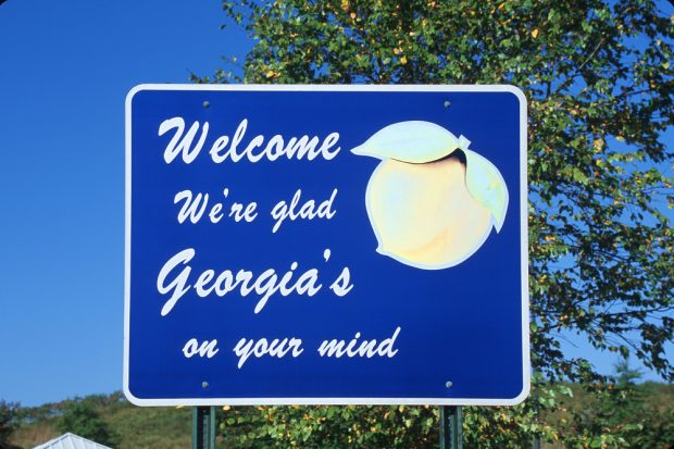 """Welcome we're glad Georgia's on your mind"" sign"