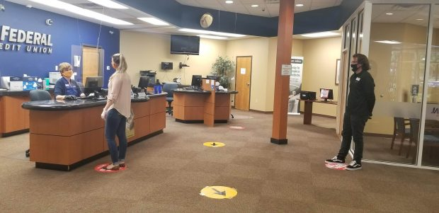 Social distancing inside the credit union branch.