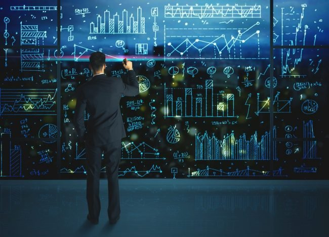 Man working on a full wall of data