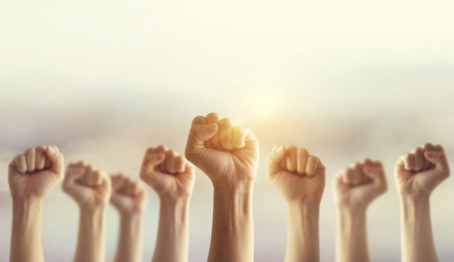 Row of fists in the air
