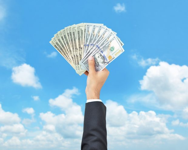employee holding cash