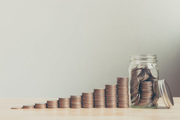 coins stacked higher and higher to show savings growth