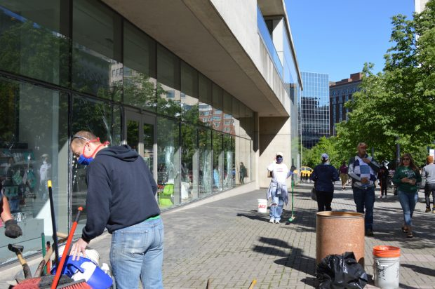 Volunteers clean up downtown Grand Rapids, Mich. after windows were broken during protests.
