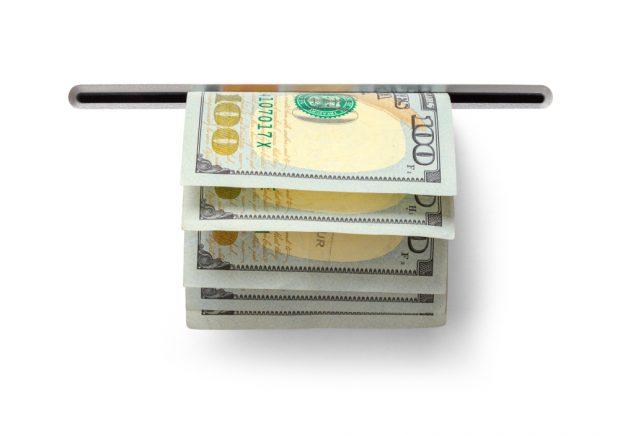 cash despensing out of a slot