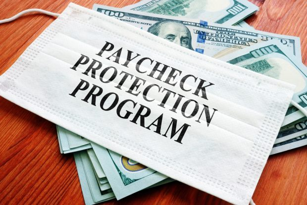 Paycheck Protection Program with cash and a mask