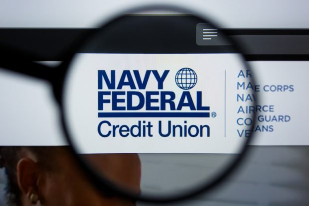 Navy Federal Credit Union logo under a magnifying glass