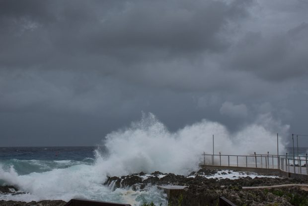 What was Tropical Storm Laura last week as it passed over Grand Cayman.