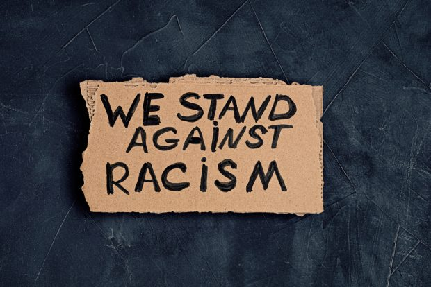 We Stand Against Racism sign