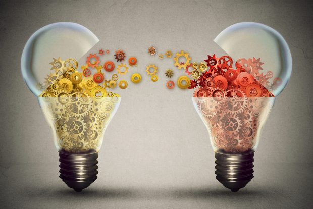 Two light bulbs with ideas coming out of them.