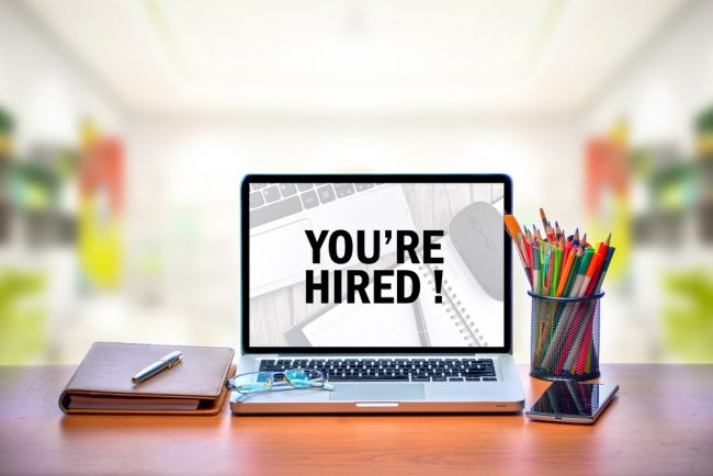 You're Hired text on laptop