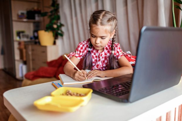 girl with laptop for virtual school from home