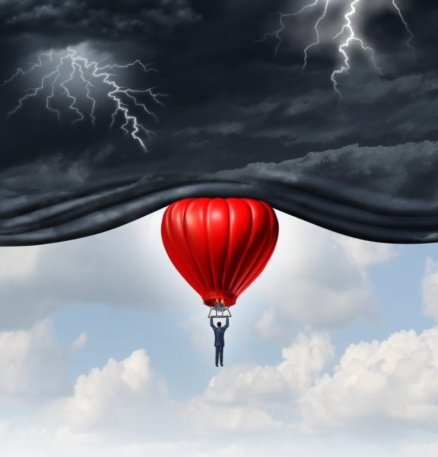economy as a red balloon floating up into stormy skies
