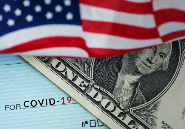 economic relief with a check and the U.S. flag