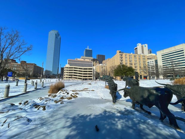 Ice and snow cover Dallas after first of five winter storms in a week.