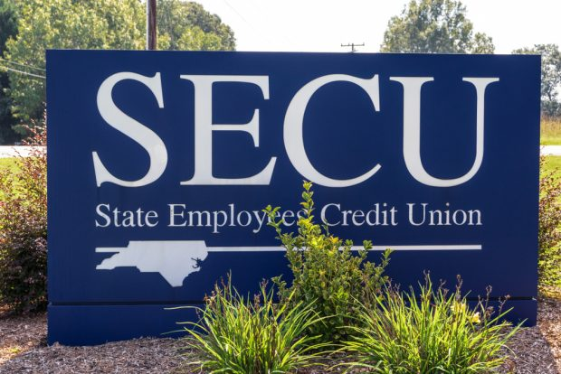 A street sign at a branch of the North Carolina State Employees' Credit Union.