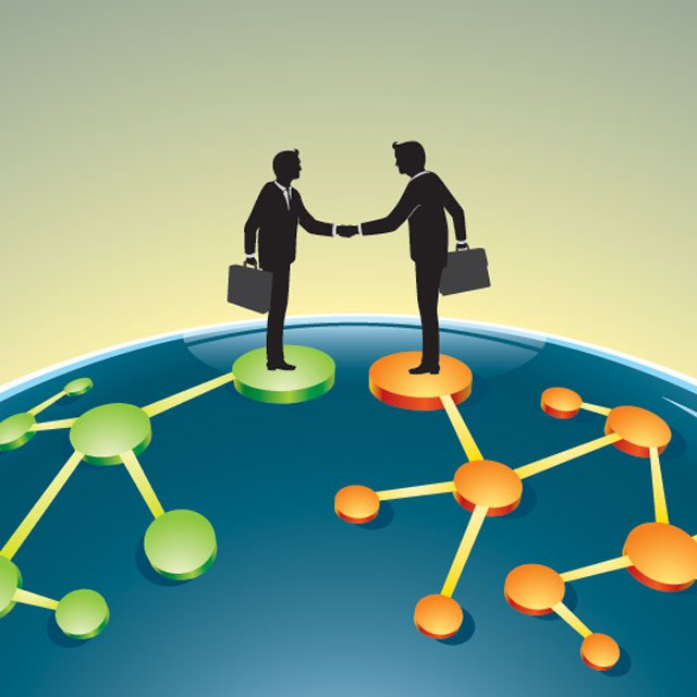 two people shaking hands over financial deal.