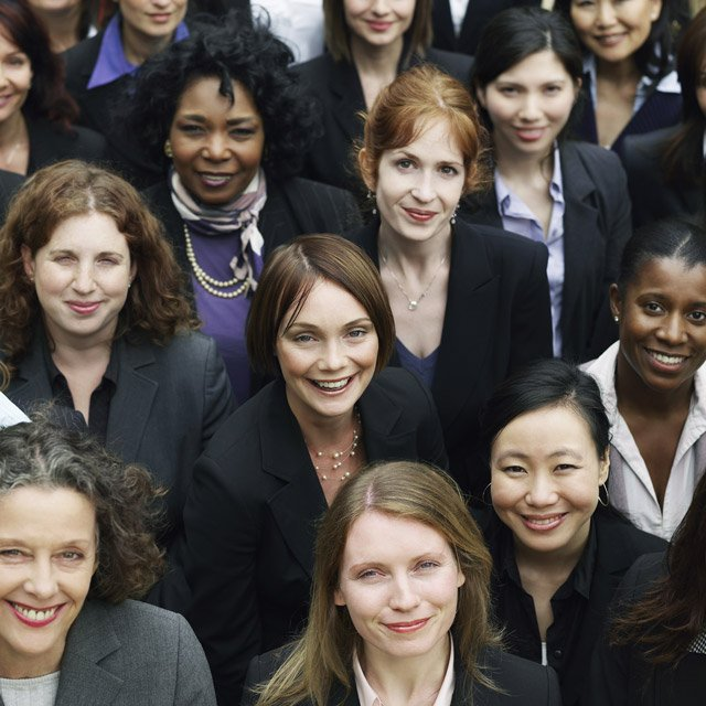 A group of professional women looking into the camera.