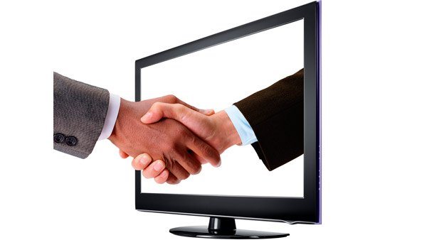 Handshake through a computer screen