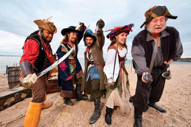 Island FCU uses singing and dancing pirates to encourage locals to tell their bank to 'walk the plank and catch the wave to better banking.'