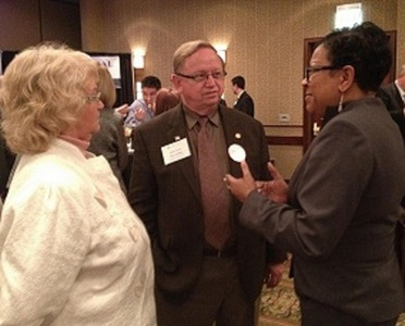 Lee Williams, right, CEO of Central Star Credit Union, talks with State Sen. Dick Kelsey, middle, and wife Doris Kelsey at a reception for the KCUA's Annual Day at the Capitol.