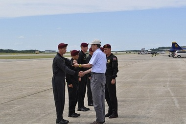 Service Credit Union President/CEO Gordon Simmons, right, receives the ceremonial baton from members of the U.S. Army Golden Knights.