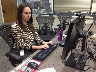 Lauren Calhoun of CUNA Mutual Group prepares for the live question-and-answer portion of her joint session with CMG's Bill Klewin (not pictured) at the Online Discovery Conference on Tuesday.