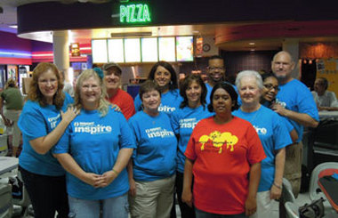 The Insight Credit Union Bowling Team, which won the trophy for highest scoring team, and Special Olympic Athletes.