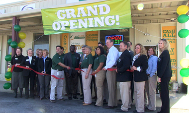 Decatur Mayor Don Kyle joined Right Choice Money Services General Manager Peter Alvarez, in cutting the ribbon at the store's grand opening ceremony on Friday, November 16.
