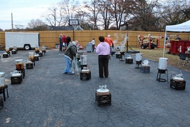 The deep frying of the turkeys gets under way Tuesday at a shelter facility in Spartanburg, S.C.